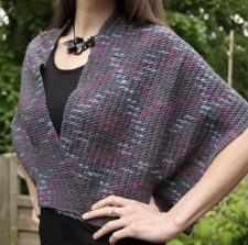 Crocheted wrap with a solid fabric and soft zigzag color patterns