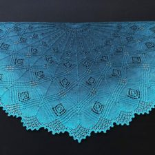 Half-circle shawl with geometric lace accented by beads