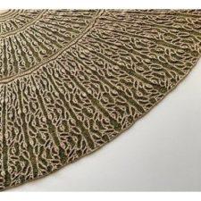 Delicate brioche in vine pattern on half-circle shawl.