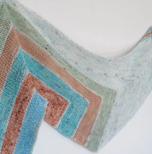 Shawl in five colors, angular patterns.