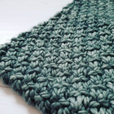 Chunky cowl in textured stitch pattern.