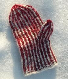 Photo of a brioche mitten atop snow