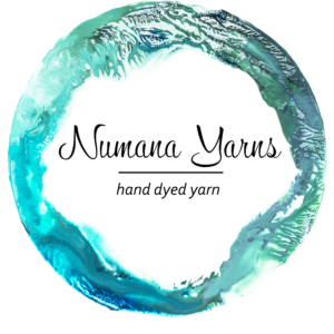 Logo looks like a watercolor painting of a circle with Numana Yarns, Hand dyed yarn written inside