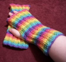 Rainbow striped ribbed fingerless mitts.