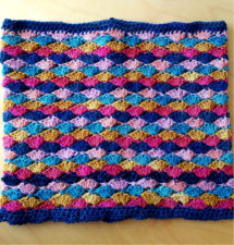 Solid crocheted cowl in several bright colors