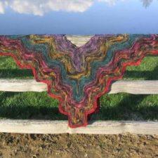 Bright, wavy-edged layers form this triangular shawl.