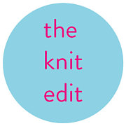 """blue circle with """"the knit edit"""" in bright pink"""