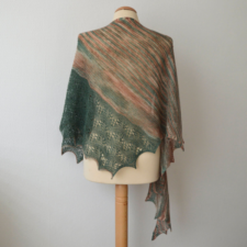 Triangular shawl with variegated wide section and wide lace band down one side.