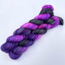 Black and purple variegated yarns.