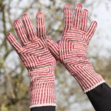 Striped gloves with geometric panels.