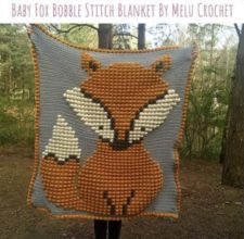 Fox pattern in bobbles on blanket.