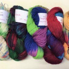 Several skeins of bright variegated yarns.