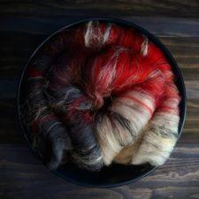 Vividly colored batt folded into a bowl.