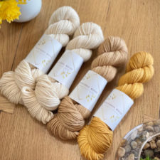 Four skeins in shades of caramel.
