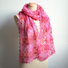 Wide crocheted scarf with floral motif throughout.