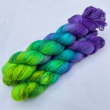 Variegated yarn goes from purple to neon green.