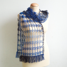 Very airy crocheted stole, nit with gradent yarn. Lace is geometric.