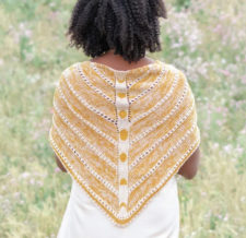 Triangular shawl with phases of the moon in colorwork down the spine.