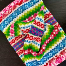 Fair Isle cowl in very bright colors. Resembles Eastern European embroidery.