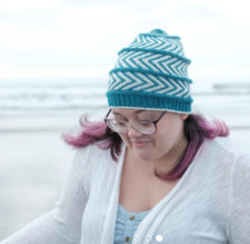 Colorwork hat featuring bands of chevrons.
