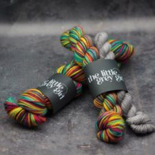 Bright, self-striping yarn with neutral mini for heels and toes.