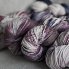 Bulky skeins in berry colors and neutrals.