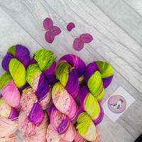 Variegated skeins in the colors of fuchsias.