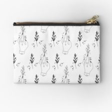 Zippered pouch with drawings of plants and well manicured hands.