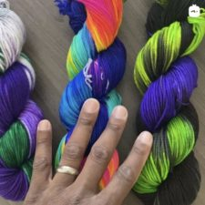 Three bright variegated skeins. Royal Earth is purples and greens. Glow is very bright in several shades, and Malice is neon green and purple.