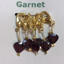 Faceted garnets on lobster claw clasps.