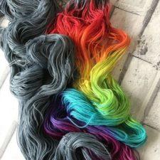 Skeins are half stormcloud color and half rainbow gradient.