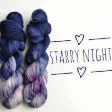 Two skeins are half deep, night-sky blue and half speckled purples and pinks.