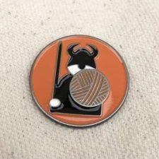 Round enamel pin with Viking.