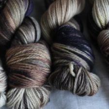 Aran weight variegated yarn in fall colors.