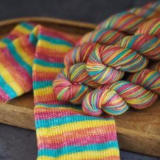 Medium-tone self-striping yarn that knits up to socks with half-inch stripes.
