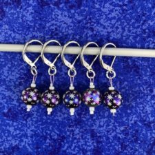 Starry stitch markers with earring back closures.