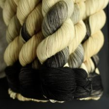 Variegated yarn in palest yellow to deep black.