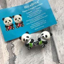 Needle stops shaped like Pandas knitting socks.