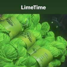 """Stack of neon green skeins. Label declares """"We Out Here."""""""