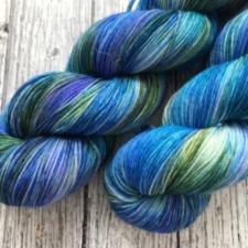 Variegated yarn skeins in sea colors.
