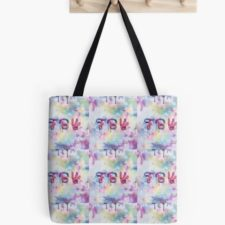 Tote bag hanging on a peg. Print is FBY and splashes of color.