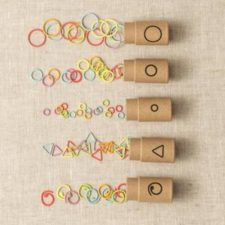 Assortment of stitch markers in different shapes.