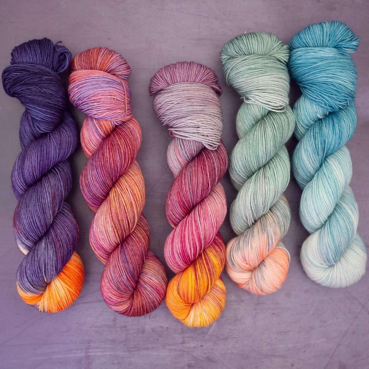 DK in medium colorways with bright accent colors.