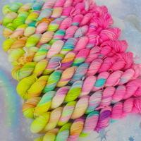 Array of pastel neon rainbow skeins.