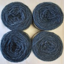 Four yarn cakes the color of blue jeans.