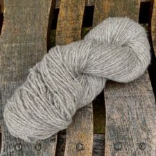 Light natural yarn on rough pallet.