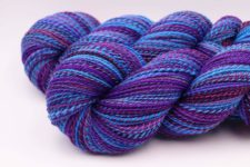 Bright, marled skeins in closely related cool colors.