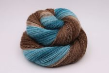 Swirled skein in two tones, one chocolate, one like the ocean.