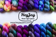 Hey Jay logo with the name between two rows of vibrant skeins
